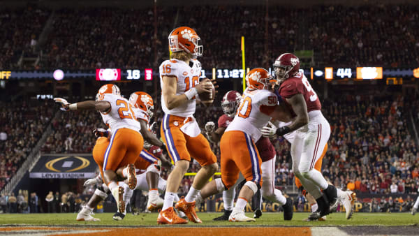 SANTA CLARA, CA - JANUARY 07: Trevor Lawrence #16 of the Clemson Tigers takes the snap against the Alabama Crimson Tide during the College Football Playoff National Championship held at Levi's Stadium on January 7, 2019 in Santa Clara, California. The Clemson Tigers defeated the Alabama Crimson Tide 44-16. (Photo by Jamie Schwaberow/Getty Images)
