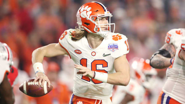 Trevor Lawrence winds up to pass against Ohio State in the CFP Semifinal in the Fiesta Bowl .
