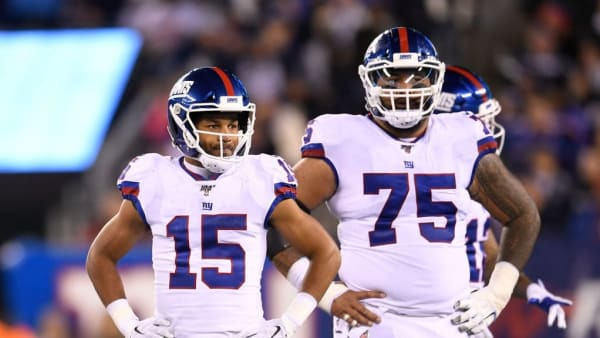 EAST RUTHERFORD, NEW JERSEY - NOVEMBER 04: Golden Tate #15 and Jon Halapio #75 of the New York Giants look on during the third quarter of the game against the Dallas Cowboys at MetLife Stadium on November 04, 2019 in East Rutherford, New Jersey. (Photo by Sarah Stier/Getty Images)