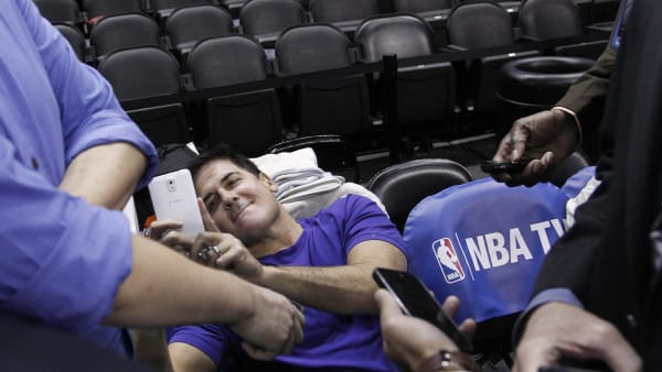 SAN ANTONIO, TX - APRIL 23: Mark Cuban owner of the Dallas Mavericks tweets a message while talking with reporters before his team plays the San Antonio Spurs in Game Two of the Western Conference Quarterfinals during the 2014 NBA Playoffs at the AT&T Center on April 23, 2014 in San Antonio, Texas. NOTE TO USER: User expressly acknowledges and agrees that, by downloading and/or using this photograph, user is consenting to the terms and conditions of the Getty Images License Agreement. (Photo by Chris Covatta/Getty Images)