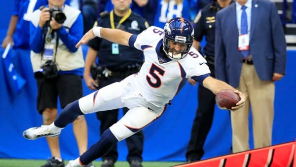 INDIANAPOLIS, INDIANA - OCTOBER 27:  Joe Flacco #5 of the Denver Broncos reaches for a first down against the Indianapolis Colts at Lucas Oil Stadium on October 27, 2019 in Indianapolis, Indiana. (Photo by Andy Lyons/Getty Images)