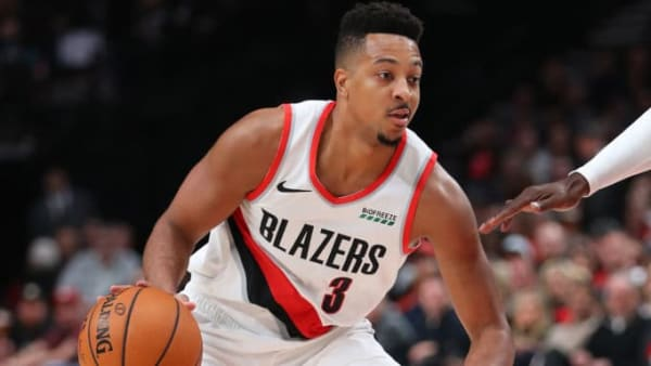PORTLAND, OREGON - OCTOBER 23: CJ McCollum #3 of the Portland Trail Blazers dribbles with the ball in the first quarter against the Denver Nuggets during their season opener at Moda Center on October 23, 2019 in Portland, Oregon. NOTE TO USER: User expressly acknowledges and agrees that, by downloading and or using this photograph, User is consenting to the terms and conditions of the Getty Images License Agreement (Photo by Abbie Parr/Getty Images)