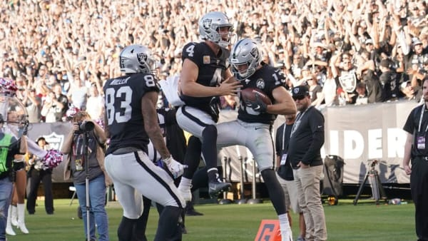 OAKLAND, CALIFORNIA - NOVEMBER 03: Hunter Renfrow #13 and Derek Carr #4 of the Oakland Raiders celebrates after Renfrow caught a touchdown pass from Carr against the Detroit Lions during the fourth quarter of an NFL football game at RingCentral Coliseum on November 03, 2019 in Oakland, California. The Raiders won the game 31-24. (Photo by Thearon W. Henderson/Getty Images)