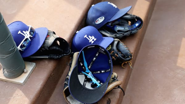 ATLANTA, GA - OCTOBER 08:  Los Angeles Dodgers hats and gloves are seen in the dugout before the start of Game Four of the National League Division Series between the Los Angeles Dodgers and the Atlanta Braves at Turner Field on October 8, 2018 in Atlanta, Georgia.  (Photo by Rob Carr/Getty Images)