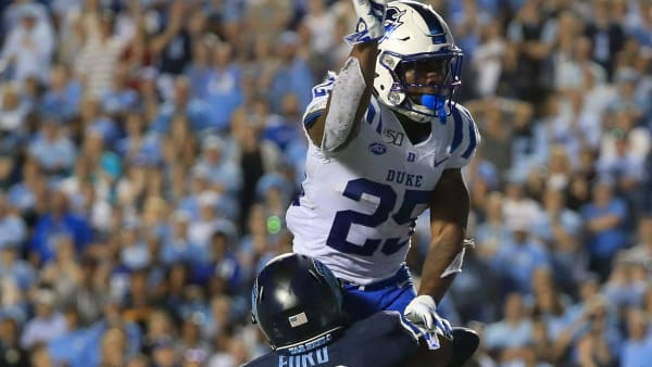 CHAPEL HILL, NORTH CAROLINA - OCTOBER 26: Deon Jackson #25 of the Duke Blue Devils throws an interception as D.J. Ford #16 of the North Carolina Tar Heels tries to stop him late in the fourth quarter during their game at Kenan Stadium on October 26, 2019 in Chapel Hill, North Carolina. (Photo by Streeter Lecka/Getty Images)