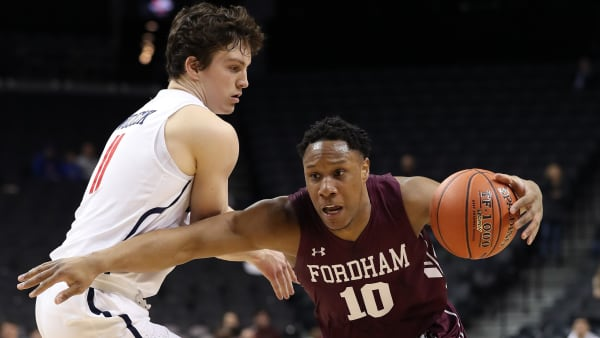 Fordham sophomore guard Ty Perry drives the ball past a defender in a game against Richmond.