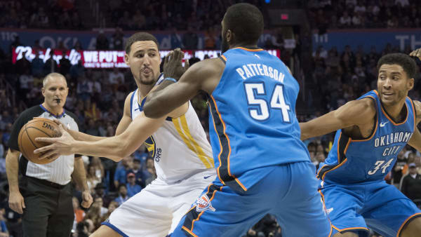 OKLAHOMA CITY, OK - NOVEMBER 22: Patrick Patterson #54 of the Oklahoma City Thunder forces Klay Thompson #11 of the Golden State Warriors to pass the ball during the second half of a NBA  game at the Chesapeake Energy Arena on November 22, 2017 in Oklahoma City, Oklahoma. NOTE TO USER: User expressly acknowledges and agrees that, by downloading and or using this photograph, User is consenting to the terms and conditions of the Getty Images License Agreement. (Photo by J Pat Carter/Getty Images)