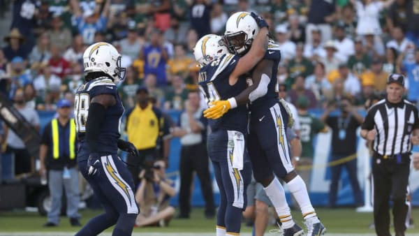 CARSON, CALIFORNIA - NOVEMBER 03:  Virgil Green #88 and Derek Watt #34 congratulate Melvin Gordon #25 of the Los Angeles Chargers after his rushing touchdown during the second half of a game at Dignity Health Sports Park on November 03, 2019 in Carson, California. (Photo by Sean M. Haffey/Getty Images)