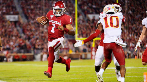 NORMAN, OK - NOVEMBER 9:  Quarterback Jalen Hurts #1 of the Oklahoma Sooners heads out of bounds just shy of the end zone against defensive back Tayvonn Kyle #10 of the Iowa State Cyclones late in the second quarter on November 9, 2019 at Gaylord Family Oklahoma Memorial Stadium in Norman, Oklahoma. The Sooners won 42-41.  (Photo by Brian Bahr/Getty Images)