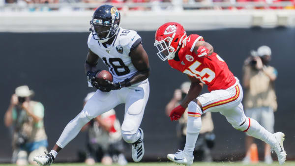 JACKSONVILLE, FLORIDA - SEPTEMBER 08: Chris Conley #18 of the Jacksonville Jaguars runs for yardage against Charvarius Ward #35 of the Kansas City Chiefs during the first quarter at TIAA Bank Field on September 08, 2019 in Jacksonville, Florida. (Photo by James Gilbert/Getty Images)
