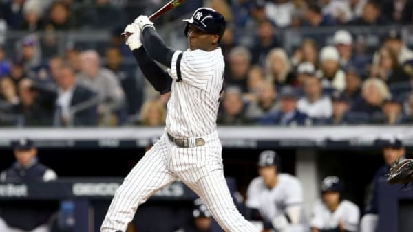 NEW YORK, NEW YORK - OCTOBER 17:  Didi Gregorius #18 of the New York Yankees hits a single against the Houston Astros during the second inning in game four of the American League Championship Series at Yankee Stadium on October 17, 2019 in New York City. (Photo by Mike Stobe/Getty Images)