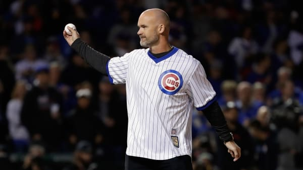 CHICAGO, IL - OCTOBER 19:  Former Chicago Cubs player David Ross throws out a ceremonial first pitch before game five of the National League Championship Series between the Los Angeles Dodgers and the Chicago Cubs at Wrigley Field on October 19, 2017 in Chicago, Illinois.  (Photo by Jamie Squire/Getty Images)