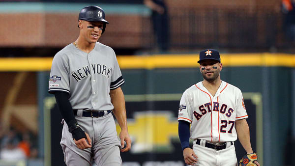 HOUSTON, TEXAS - OCTOBER 19: Aaron Judge #99 of the New York Yankees and Jose Altuve #27 of the Houston Astros talk during Game 6 of the American League Championship Series at Minute Maid Park on October 19, 2019 in Houston, Texas. (Photo by Bob Levey/Getty Images)