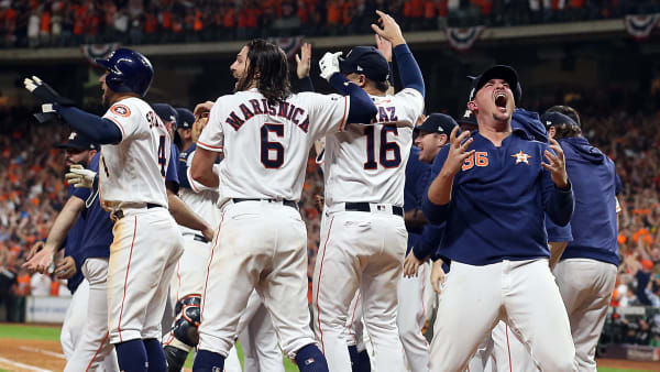 HOUSTON, TEXAS - OCTOBER 19: Will Harris #36 of the Houston Astros celebrates with this teammates after winning the A:LCS Championship against the New York Yankees in Game 6 of the American League Championship Series at Minute Maid Park on October 19, 2019 in Houston, Texas. (Photo by Bob Levey/Getty Images)