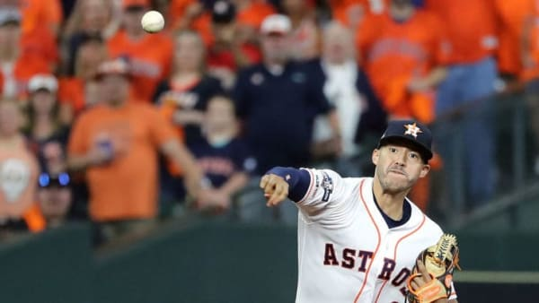 HOUSTON, TEXAS - OCTOBER 19:  Carlos Correa #1 of the Houston Astros throws out the runner against the New York Yankees during the first inning in game six of the American League Championship Series at Minute Maid Park on October 19, 2019 in Houston, Texas. (Photo by Elsa/Getty Images)
