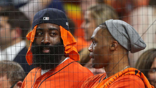 HOUSTON, TEXAS - OCTOBER 19: James Harden and Russell Westbrook of the Houston Rockets watch Game 6 of the American League Championship Series between the Houston Astros and New York Yankees at Minute Maid Park on October 19, 2019 in Houston, Texas. (Photo by Bob Levey/Getty Images)