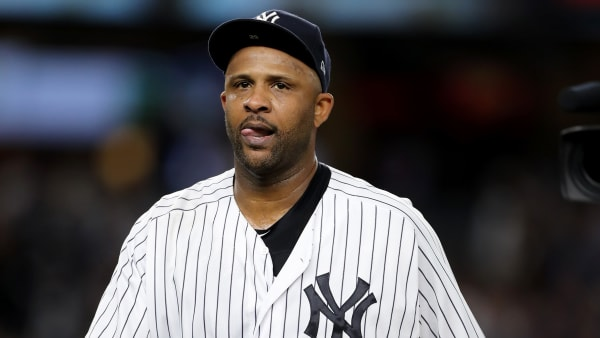 NEW YORK, NEW YORK - SEPTEMBER 18:  CC Sabathia #52 of the New York Yankees heads to the dugout after he is pulled from the game in the third inning against the Los Angeles Angels at Yankee Stadium on September 18, 2019 in the Bronx borough of New York City. (Photo by Elsa/Getty Images)