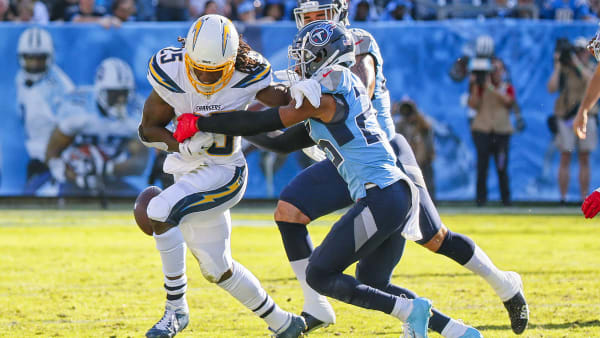 NASHVILLE, TENNESSEE - OCTOBER 20:  Adoree' Jackson #25 of the Tennessee Titans pokes the ball out of the hands of Melvin Gordon #25 of the Los Angeles Chargers during the first half at Nissan Stadium on October 20, 2019 in Nashville, Tennessee. (Photo by Frederick Breedon/Getty Images)