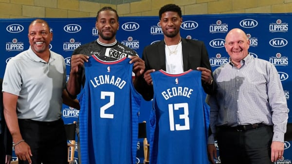 LOS ANGELES, CA - JULY 24: (L-R) Head coach Doc Rivers, Paul George, Kawhi Leonard and owner Steve Ballmer of the Los Angeles Clippers attend the Paul George and Kawhi Leonard introductory press conference at Green Meadows Recreation Center on July 24, 2019 in Los Angeles, California. NOTE TO USER: User expressly acknowledges and agrees that, by downloading and or using this photograph, User is consenting to the terms and conditions of the Getty Images License Agreement. (Photo by Kevork Djansezian/Getty Images)