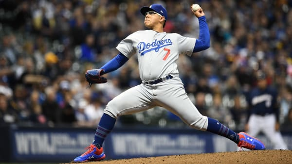 MILWAUKEE, WISCONSIN - APRIL 18:  Julio Urias #7 of the Los Angeles Dodgers throws a pitch during the first inning against the Milwaukee Brewers at Miller Park on April 18, 2019 in Milwaukee, Wisconsin. (Photo by Stacy Revere/Getty Images)