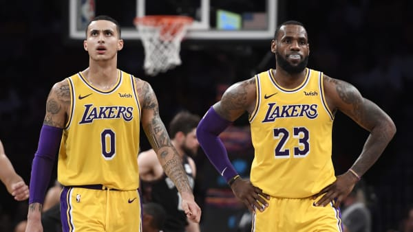 NEW YORK, NEW YORK - DECEMBER 18: LeBron James #23, Kyle Kuzma #0, and Josh Hart #3 of the Los Angeles Lakers react during a timeout in the fourth quarter of the game against the Los Angeles Lakers at Barclays Center on December 18, 2018 in New York City. NOTE TO USER: User expressly acknowledges and agrees that, by downloading and or using this photograph, User is consenting to the terms and conditions of the Getty Images License Agreement. (Photo by Sarah Stier/Getty Images)