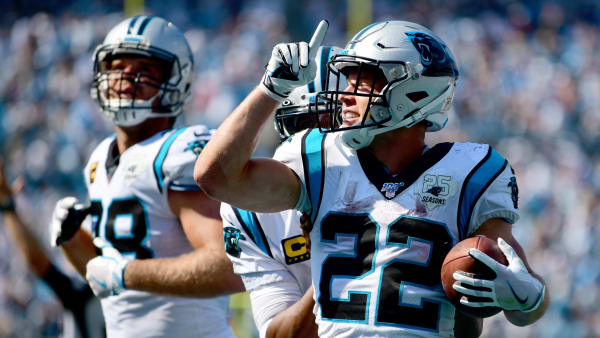 CHARLOTTE, NORTH CAROLINA - SEPTEMBER 08: Christian McCaffrey #22 of the Carolina Panthers celebrates after a touchdown in the fourth quarter during their game against the Los Angeles Rams at Bank of America Stadium on September 08, 2019 in Charlotte, North Carolina. (Photo by Jacob Kupferman/Getty Images)