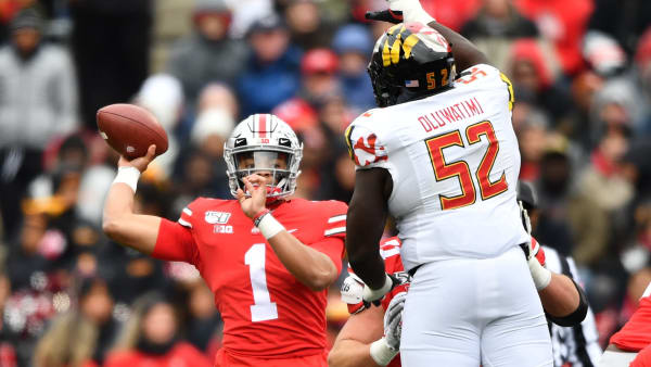 COLUMBUS, OH - NOVEMBER 9:  Quarterback Justin Fields #1 of the Ohio State Buckeyes passes over the defense of Oluwaseun Oluwatimi #52 of the Maryland Terrapins in the first quarter at Ohio Stadium on November 9, 2019 in Columbus, Ohio.  (Photo by Jamie Sabau/Getty Images)