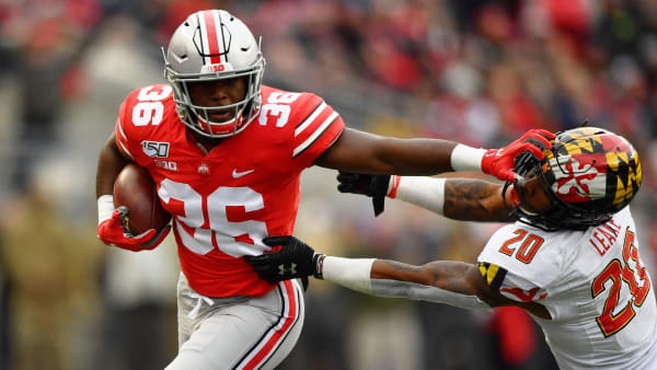 COLUMBUS, OH - NOVEMBER 9:  K'Vaughan Pope #36 of the Ohio State Buckeyes stiff arms Javon Leake #20 of the Maryland Terrapins after intercepting a pass in the third quarter at Ohio Stadium on November 9, 2019 in Columbus, Ohio. Ohio State defeated Maryland 73-14.  (Photo by Jamie Sabau/Getty Images)