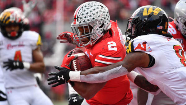 COLUMBUS, OH - NOVEMBER 9:  J.K. Dobbins #2 of the Ohio State Buckeyes scores on a 7-yard touchdown run in the second quarter as Marcus Lewis #8 of the Maryland Terrapins defends at Ohio Stadium on November 9, 2019 in Columbus, Ohio.  (Photo by Jamie Sabau/Getty Images)