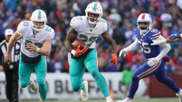BUFFALO, NY - DECEMBER 30: Kalen Ballage #27 of the Miami Dolphins runs with the ball in the third quarter during NFL game action against the Buffalo Bills at New Era Field on December 30, 2018 in Buffalo, New York. (Photo by Tom Szczerbowski/Getty Images)