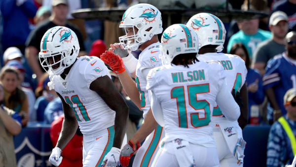 ORCHARD PARK, NEW YORK - OCTOBER 20: DeVante Parker #11 of the Miami Dolphins celebrates with teammates after scoring a touchdown during the second quarter of an NFL game against the Buffalo Bills at New Era Field on October 20, 2019 in Orchard Park, New York. (Photo by Bryan M. Bennett/Getty Images)