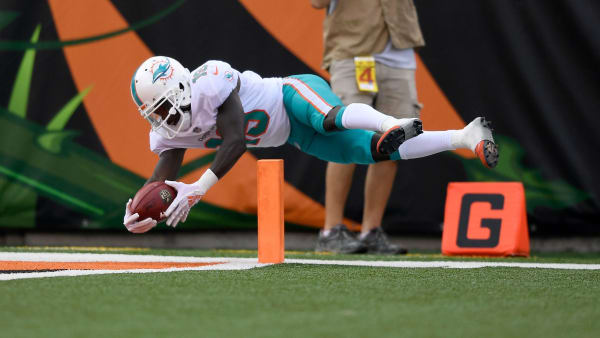 CINCINNATI, OH - OCTOBER 7:  Jakeem Grant #19 of the Miami Dolphins dives for a touchdown after returning a punt 70 yards during the second quarter of the game against the Cincinnati Bengals at Paul Brown Stadium on October 7, 2018 in Cincinnati, Ohio. (Photo by Bobby Ellis/Getty Images)