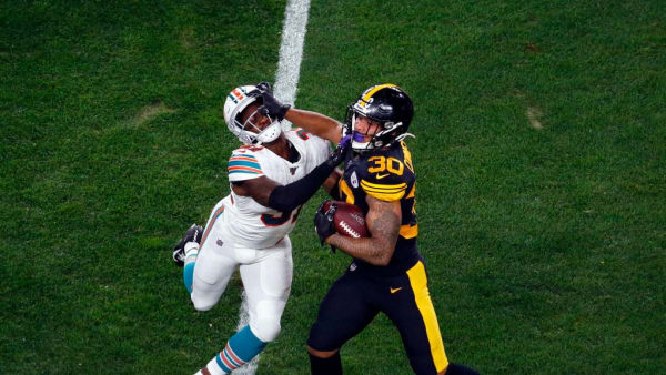PITTSBURGH, PA - OCTOBER 28:  James Conner #30 of the Pittsburgh Steelers stiff arms Ken Webster #31 of the Miami Dolphins on October 28, 2019 at Heinz Field in Pittsburgh, Pennsylvania.  (Photo by Justin K. Aller/Getty Images)