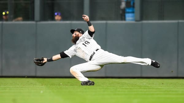 DENVER, CO - AUGUST 17:  Charlie Blackmon #19 of the Colorado Rockies makes a diving catch for an out in the ninth inning of a game against the Miami Marlins  at Coors Field on August 17, 2019 in Denver, Colorado. (Photo by Dustin Bradford/Getty Images)