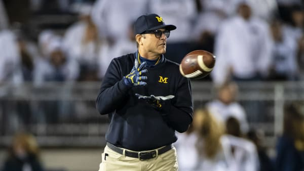 UNIVERSITY PARK, PA - OCTOBER 19:  Head coach Jim Harbaugh of the Michigan Wolverines participates in warm ups before the game against the Penn State Nittany Lions on October 19, 2019 at Beaver Stadium in University Park, Pennsylvania.  (Photo by Brett Carlsen/Getty Images)