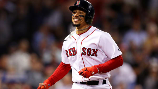 BOSTON, MASSACHUSETTS - SEPTEMBER 05: Mookie Betts #50 of the Boston Red Sox returns to the dugout after hitting a home run against the Minnesota Twins during the fourth inning at Fenway Park on September 05, 2019 in Boston, Massachusetts. (Photo by Maddie Meyer/Getty Images)