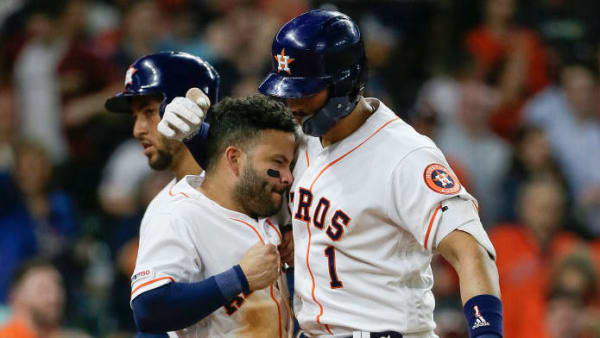 HOUSTON, TEXAS - APRIL 22: Carlos Correa #1 of the Houston Astros receives congratulations from Jose Altuve #27 after hitting a three run home run in the seventh inning against the Minnesota Twins at Minute Maid Park on April 22, 2019 in Houston, Texas. (Photo by Bob Levey/Getty Images)