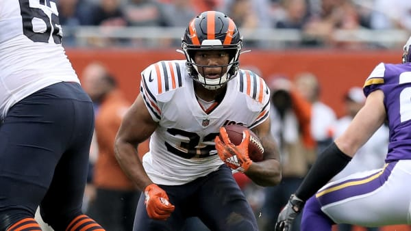 CHICAGO, ILLINOIS - SEPTEMBER 29:  David Montgomery #32 of the Chicago Bears runs with the ball while being chased by Harrison Smith #22 of the Minnesota Vikings in the second quarter at Soldier Field on September 29, 2019 in Chicago, Illinois. (Photo by Dylan Buell/Getty Images)