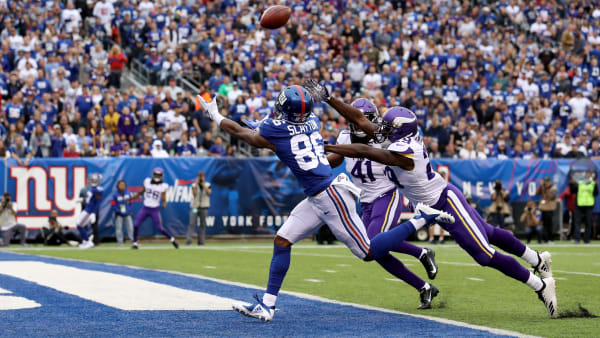 EAST RUTHERFORD, NEW JERSEY - OCTOBER 06: Darius Slayton #86 of the New York Giants catches a 35 yard touchdown pass thrown by Daniel Jones #8 against Xavier Rhodes #29 and Anthony Harris #41 of the Minnesota Vikings during the second quarter in the game at MetLife Stadium on October 06, 2019 in East Rutherford, New Jersey. (Photo by Al Bello/Getty Images)