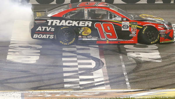 RICHMOND, VIRGINIA - SEPTEMBER 21: Martin Truex Jr., driver of the #19 Bass Pro Shops Toyota, celebrates with a burnout after winning the Monster Energy NASCAR Cup Series Federated Auto Parts 400 at Richmond Raceway on September 21, 2019 in Richmond, Virginia. (Photo by Brian Lawdermilk/Getty Images)
