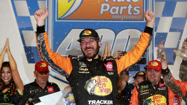 RICHMOND, VIRGINIA - SEPTEMBER 21: Martin Truex Jr., driver of the #19 Bass Pro Shops Toyota, celebrates in Victory Lane after winning the Monster Energy NASCAR Cup Series Federated Auto Parts 400 at Richmond Raceway on September 21, 2019 in Richmond, Virginia. (Photo by Sean Gardner/Getty Images)