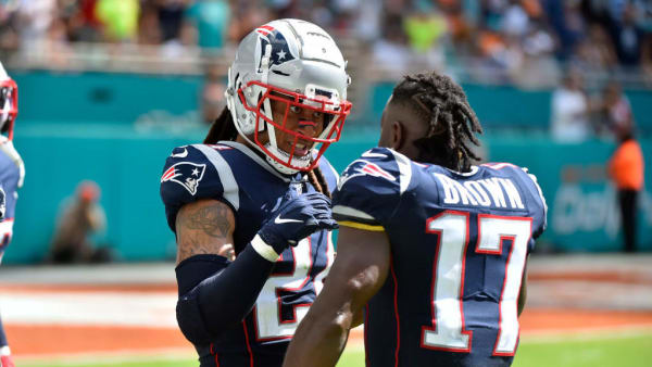 MIAMI, FL - SEPTEMBER 15: Stephon Gilmore #24 of the New England Patriots is congratulated by Antonio Brown #17 of the New England Patriots after returning a touchdown in the fourth quarter against the Miami Dolphins at Hard Rock Stadium on September 15, 2019 in Miami, Florida. (Photo by Eric Espada/Getty Images)