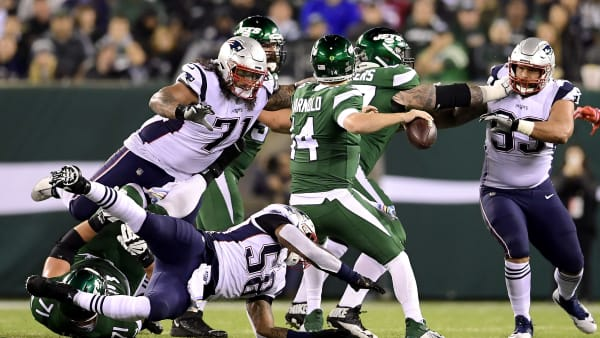 EAST RUTHERFORD, NEW JERSEY - OCTOBER 21:  Danny Shelton #71 of the New England Patriots is called for roughing the passer as he hits Sam Darnold #14 of the New York Jets during the first half at MetLife Stadium on October 21, 2019 in East Rutherford, New Jersey. (Photo by Steven Ryan/Getty Images)