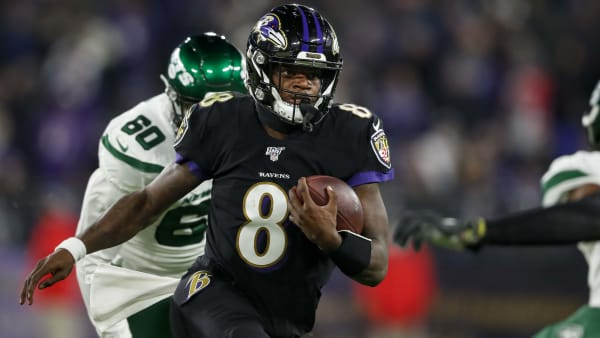 Lamar Jackson runs the ball in a game against the New York Jets.