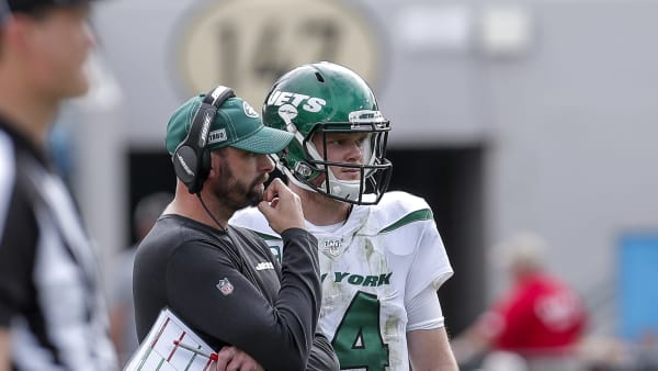 JACKSONVILLE, FL - OCTOBER 27: Head coach Adam Gase of the New York Jets talks with quarterback Sam Darnold #14 during a timeout against the Jacksonville Jaguars at TIAA Bank Field on October 27, 2019 in Jacksonville, Florida. The Jaguars defeated The Jets 29 to 15. (Photo by Don Juan Moore/Getty Images)