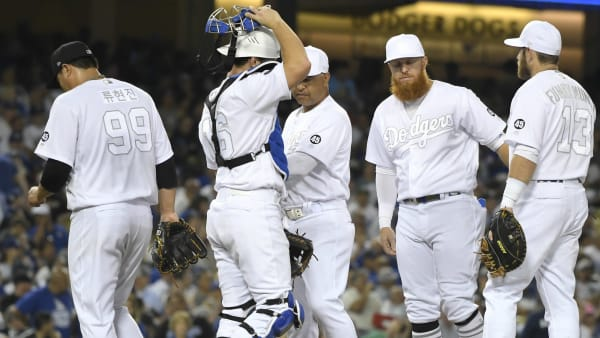 LOS ANGELES, CA - AUGUST 23: Hyun-Jin Ryu #99 of the Los Angeles Dodgers is taken out from the game after giving up a grand slam to Didi Gregorius #18 of the New York Yankees in the fifth inning at Dodger Stadium on August 23, 2019 in Los Angeles, California. Teams are wearing special color schemed uniforms with players choosing nicknames to display for Players' Weekend. (Photo by John McCoy/Getty Images)