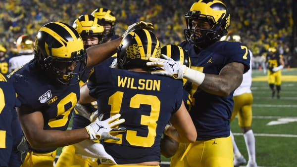 ANN ARBOR, MICHIGAN - OCTOBER 26: Donovan Peoples-Jones #9 and Tarik Black #7 celebrate with Tru Wilson #13 of the Michigan Wolverines after scoring a touchdown during a college football game against the Notre Dame Fighting Irish at Michigan Stadium on October 26, 2019 in Ann Arbor, MI. (Photo by Aaron J. Thornton/Getty Images)