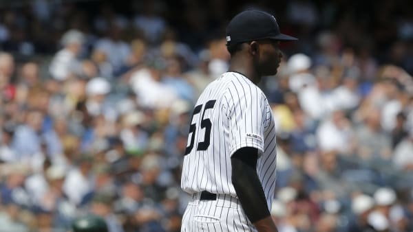 NEW YORK, NEW YORK - AUGUST 31:   Domingo German #55 of the New York Yankees stands on the mound after surrendering a fourth inning two run home run against Matt Olson #28 of the Oakland Athletics at Yankee Stadium on August 31, 2019 in New York City. (Photo by Jim McIsaac/Getty Images)