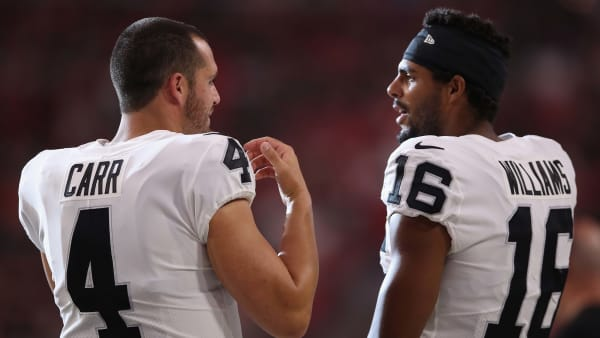 GLENDALE, ARIZONA - AUGUST 15:  Quarterback Derek Carr #4 and wide receiver Tyrell Williams #16 of the Oakland Raiders talk on the sidelines during the first half of the NFL preseason game against the Arizona Cardinals at State Farm Stadium on August 15, 2019 in Glendale, Arizona. (Photo by Christian Petersen/Getty Images)
