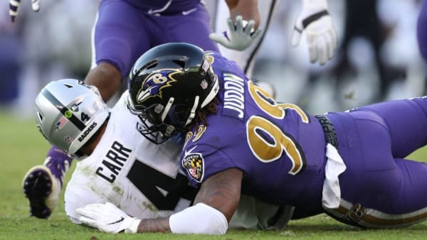 BALTIMORE, MARYLAND - NOVEMBER 25: Outside linebacker Matt Judon #99 of the Baltimore Ravens sacks quarterback Derek Carr #4 of the Oakland Raiders during the fourth quarter at M&T Bank Stadium on November 25, 2018 in Baltimore, Maryland. (Photo by Patrick Smith/Getty Images)